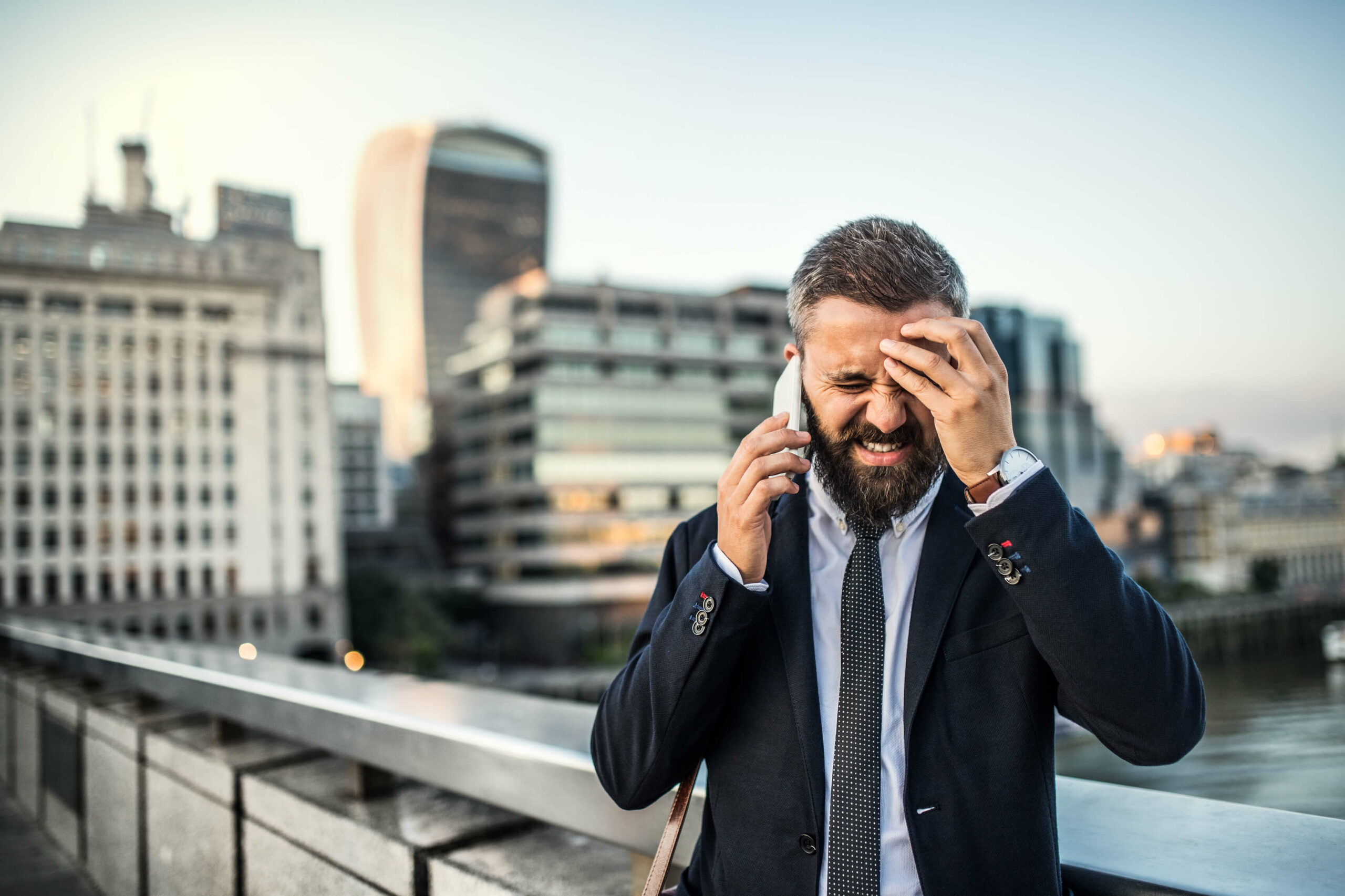 Frustrated Man that Needs a Client Reminder Solution
